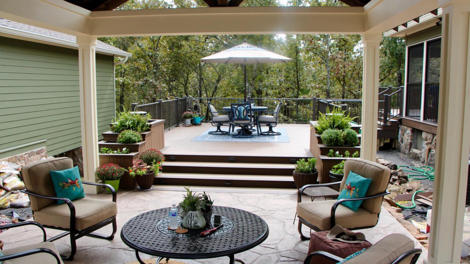 New TimberTech Deck extending off of a flagstone patio